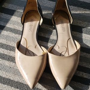 Nude and black pointed toe dress flats